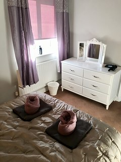 Bright and airy room with a nice makeup mirror