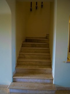 Stairs to 2nd floor suites.