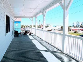 Deep wrap-around veranda with picnic table and sitting area to enjoy Gulf views.