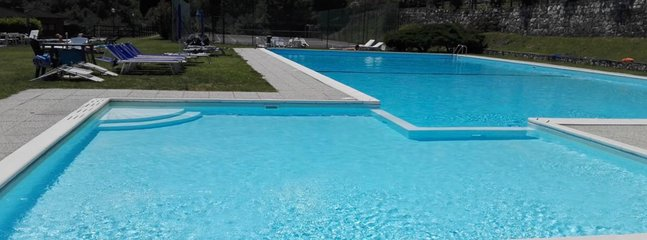 The big swimming pool in the green