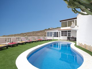 Private heated pool, sea and mountain views from the terrace.