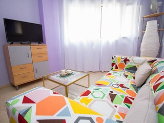 Central Colorful Flat with Parking