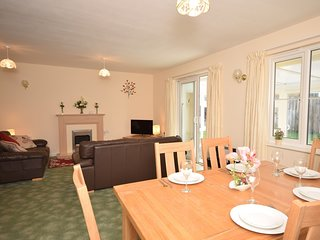 Dining area with patio doors leading to sun room