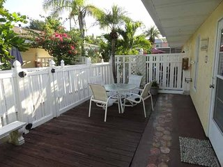 Sleeping 6, this 2BR/1BA Condo is Close to Tropical Gulf Waters, Shops, and Food