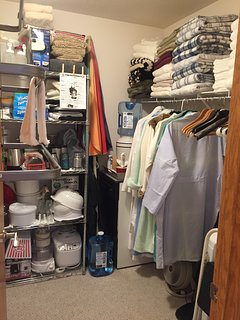 Spacious walk-in closet with extra linens, cooking gear and room for clothing.