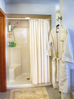 Separate shower with handheld device and overhead. Bathrobes, etc.