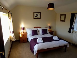 The particularly spacious double room has dual aspect countryside views.