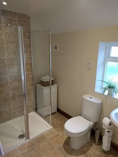The shower room is on the same floor as the bedrooms and sitting room and has a large shower.