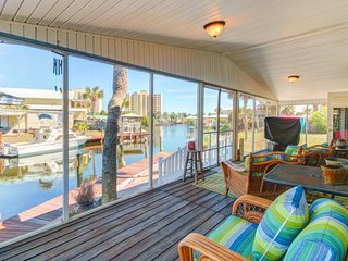 Waterfront home with dock space for boat, screened porch, and amazing views!