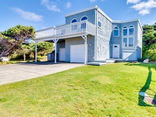 Oceanfront home with balcony, wood stove, and spectacular sea views!