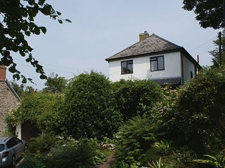 CAMELLIA HOUSE, much loved detached house with indoor swimming pool, close to be