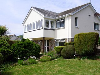 1 GWELENYS ROAD, smart, split-level detached house with stunning sea views. In M