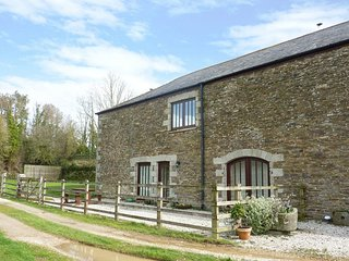 GARE BARN COTTAGE, impressive, pet friendly converted stone barn on 370 acre wor