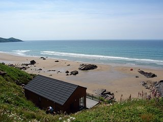CLIFF END, smart cliffside chalet with uninterrupted, panoramic sea views. Millb