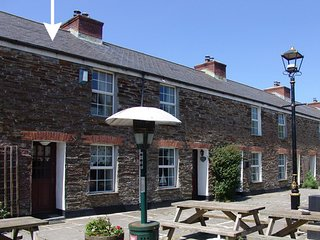 PRIMROSE COTTAGE, pretty, terraced cottage with views over the Camel estuary