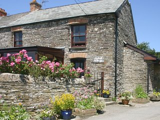 UPHILL COTTAGE, traditional, end-of-terrace cottage in quiet location with rural