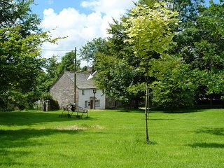 CHURCHGATE COTTAGE, cosy and comfortable 17th century cottage beside the village