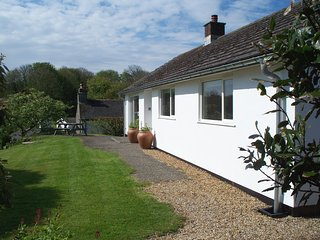 ORCHARD VIEW, secluded detached bungalow with wood burning stove and table tenni