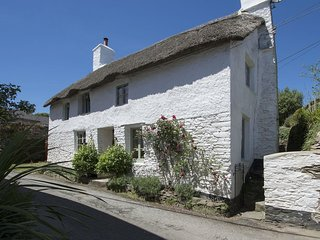 THE COTTAGE, stylish, thatched, Grade II listed cottage with wood burning stove,