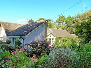 GAMEHOUSE COTTAGE, smart, spacious single-storey cottage with wood burning stove