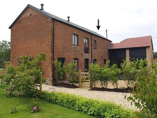 ORCHARD COTTAGE,  converted Victorian hay barn on Devon smallholding, surrounded