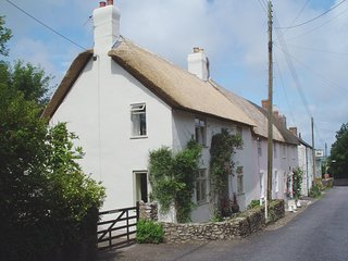WINDWHISTLE COTTAGE, pretty thatched cottage with open fire in peaceful village,