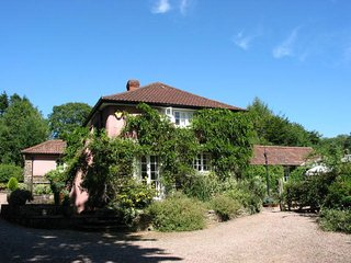THE CLOCK HOUSE, detached Exmoor house with private 2 acre garden and croquet la