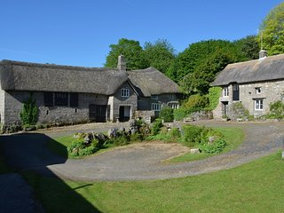 HOLE FARM, thatched, medieval Devon longhouse with big garden and grounds to wan