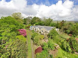 MOORSIDE COTTAGE, smart, spacious cottage with pretty garden, close to open