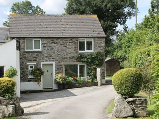 THE OLD BYRE, Smart detached cottage with wood burning stove in idyllic War