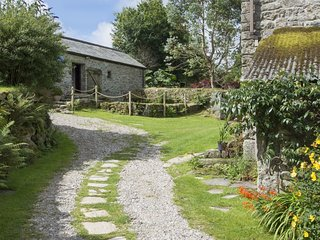 BUSTER BARN, detached, single-storey converted granite barn with pond, hillside