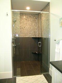 GLENORA BATHROOM: large walk-in shower; hand shower; infinity drain