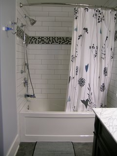 QUINTE BATHROOM:  bathtub and shower combo & hand shower;  bath toys for kids