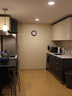 Has a fully functional and considerably equipped kitchen with cookwares and dining wares