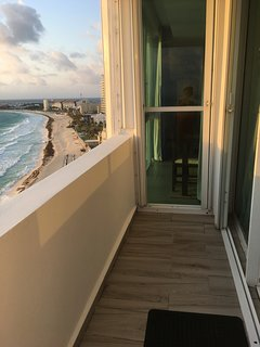 ONE SIDE OF YOUR WRAPAROUND BALCONY!! YOU ARE SO CLOSE TO THE OCEAN! YOU FEEL YOU ARE IN IT!!