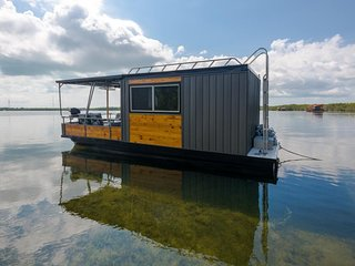 Eco-friendly houseboat with all the essentials right on the water!