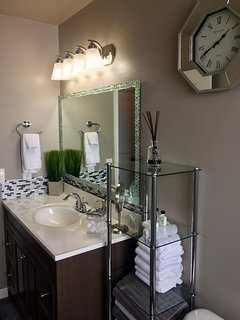 Beautiful bathroom with plenty of fresh linens.