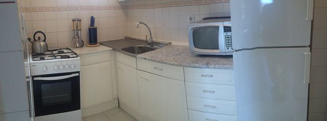 Kitchen is equipped with fridge, oven/cooker, toaster,microwave...