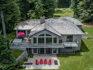 Secluded cottage on 350 feet of sandy lakefront with outdoor hot tub