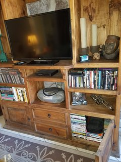 flat screen TV and plenty of DVD's
