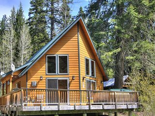 Spacious, secluded cabin w/ private hot tub near year-round fun, on the river!