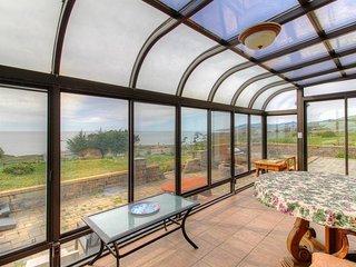 Oceanview home w/ incredible views, sunroom, courtyard - near beaches/trails!