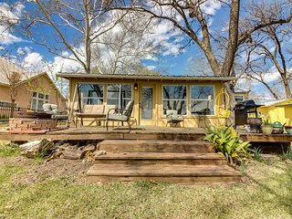 Dog-friendly lakefront home with dock, back porch, & views of the water