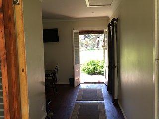 hallway with view towards front door of homestead