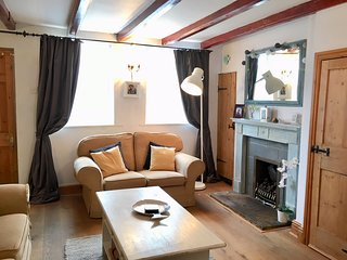 Gowland Cottage offers historic charm alongside modern comfort with original beams and oak floors.