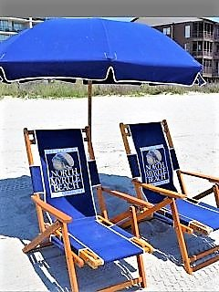Beach chair rentals offered by the Town of NMB available within a few feet from the cond