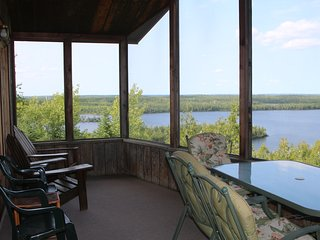 Stunning view of Moose Lake from the screened in porch