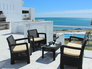 Penthouse Beach Front Apartment with Incredible Views, Hot Tub and Barbecue.