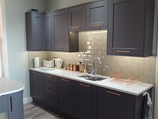 Kitchen with hot water tap