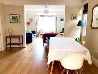 The Front room that joins onto the Dining room both with estuary views.